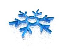 Snowflake lying on ice Royalty Free Stock Photos