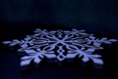 Snowflake. Macro snowflake on a black background, symbol of winter and new year Stock Photos
