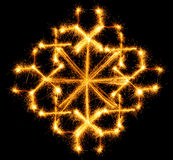 Snowflake made by sparkler on a black Royalty Free Stock Photo