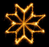 Snowflake made by sparkler on a black Royalty Free Stock Images