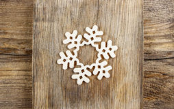 Snowflake made of wood Stock Photos
