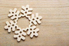 Snowflake made of wood on wooden background Royalty Free Stock Image