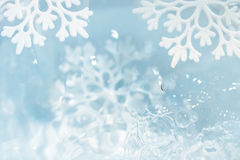 Snowflake melts in water drops macro background Royalty Free Stock Photos