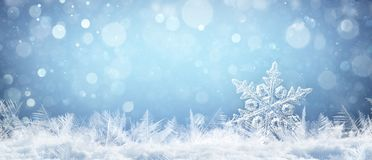 Snowflake On Natural Snowdrift Close Up. Christmas And Winter Background royalty free stock photo