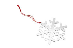 Snowflake Ornament. Silver snowflake ornament with a red ribbon isolated on white Stock Photo