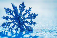 Snowflake ornament. In real snow in winter Stock Image