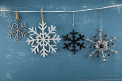 Snowflake Ornaments in Descending Height. Hanging from white ribbon Stock Photo