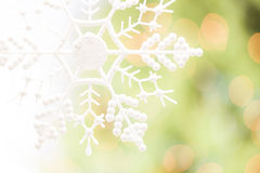 Snowflake Over an Abstract Green and Gold Background Stock Photography