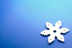 Snowflake over blue Royalty Free Stock Photo
