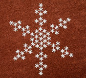 Snowflake over red glitter background. Stock Photo