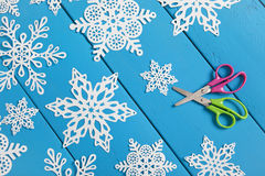 Snowflake Paper Crafts. Snowflakes cut from paper.  A traditional Christmas arts and crafts project Stock Photo