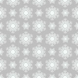 Snowflake pattern on  gray background Stock Photography