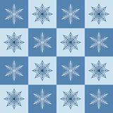 Snowflake pattern. Seamless vector checkered winter background Royalty Free Stock Images