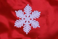 Snowflake on the red Royalty Free Stock Images