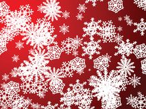 Snowflake red new. A snow flake scene falling from the sky in red Stock Photography
