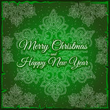 Snowflake and sample text on a green background Stock Photos