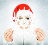 Snowflake in Santa girl hands Stock Photos