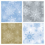Snowflake seamless background. Four different seamless winter backgrounds with snowflakes design Royalty Free Stock Photography