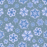 Snowflake seamless pattern. Holiday wallpaper. Winter endless background. Set of blue snowflakes. Stock Photography