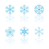 Snowflake set. Different blue snowflakes on white reflection plate Royalty Free Stock Photo