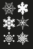 SNOWFLAKE SET VECTOR. Isolated snowflake vector set on black Stock Photography