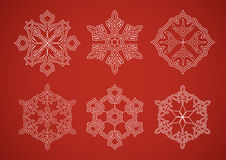 Snowflake set on red background Royalty Free Stock Images