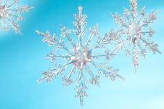 Snowflake shape. Photo on the blue background Royalty Free Stock Photos