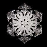 Snowflake shape. Photo on the black background Royalty Free Stock Photo