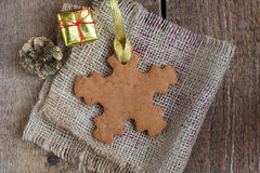 Snowflake shape gingerbread cookie Royalty Free Stock Photography