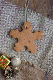 Snowflake shape gingerbread cookie Stock Photos