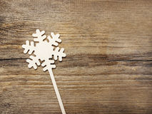 Snowflake shape made of wood Royalty Free Stock Images