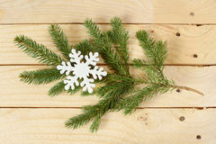 Snowflake shape on pine branch Royalty Free Stock Images