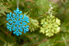Snowflake shaped Christmas ornaments. Blue and green snowflake shaped Christmas ornaments Royalty Free Stock Images