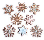 Snowflake shaped gingerbread cookies home made. Homemade snowflake shaped gingerbread cookies with sugar icing, on white background isolated stock images