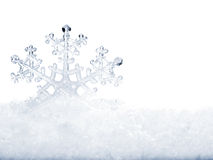 Snowflake in snow. Snowflake in white snow. Isolated Stock Image