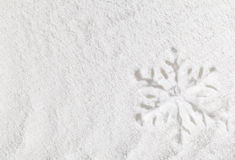 Snowflake in snow Stock Images