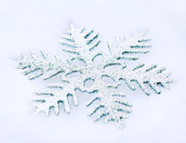 Snowflake in the snow Royalty Free Stock Image