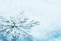 Snowflake in snow. Christmas Royalty Free Stock Photo
