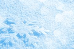 Snowflake in the snow. Christmas background with decorative snowflake on brilliant snow stock image