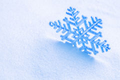 Snowflake on the snow. Stock Photography