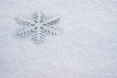 Snowflake in snow Stock Photo
