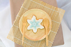 Snowflake sugar cookie on dish Stock Images
