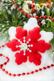 Snowflake toy Christmas decoration over decorated tree Stock Images