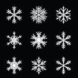 Snowflake vector icon background set. On black background Royalty Free Stock Photos