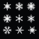 Snowflake vector icon background set. On black background Stock Photos