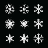 Snowflake vector icon background set. On black background Royalty Free Stock Images