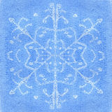 Snowflake watercolor. Watercolor a white snowflake on a blue background Royalty Free Stock Images