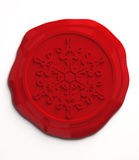 Snowflake wax seal. On white Stock Photography