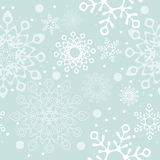 Snowflake of white color. Seamless background on Merry Christmas and new year. The depicts the snowflake of white color and various designs on a blue background Royalty Free Stock Images