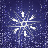 Snowflake from white paper on a color background Royalty Free Stock Photography